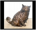 Bronze Cat Looking On
