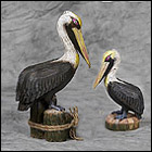 Romantic Pelican Couple Sculptures black, brown pelican statues