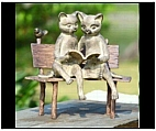 Boy and Girl Reading Cats on a Bench